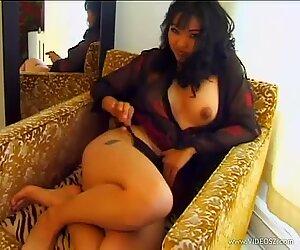 Seductive Mika Tan loves teasing her juicy moist pussy