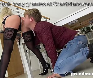 Bossy grandma spanks young boy and fucks him with strapon