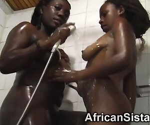 Busty African lesbos washing bodies in shower