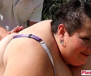Fat dark hair chick face sitting sucking picnic