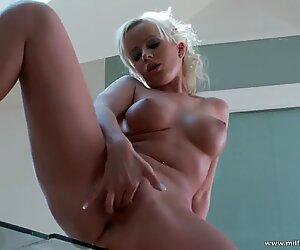 huge-titted light-haired milf rubs her wet twat