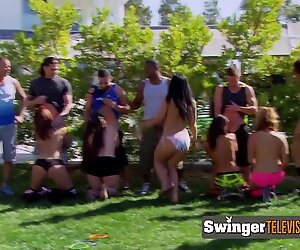 Men line up while the wives take turns showing them who can suck them off the best. One BJ at a time