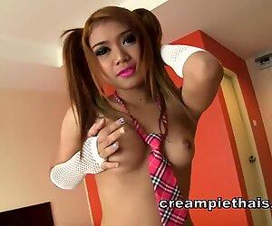 Super cute Thai girl in pigtails loves dick