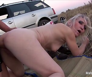 Blonde mature sucks and fucks outdoors