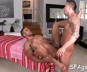 Male masseur is delighting a chubby gay bear